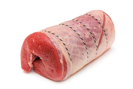 rolled: Brisket of beef joint (1.3kg) isolated on a white studio background.