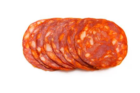 Sliced Spanish chorizo sausage isolated on a white studio. Stock Photo