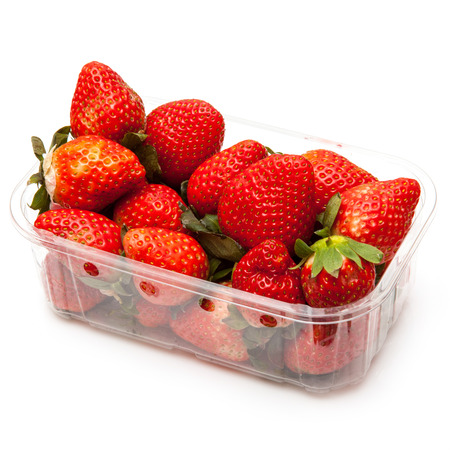 Box or punnet of strawberries isolated on a white studio background. Stock Photo