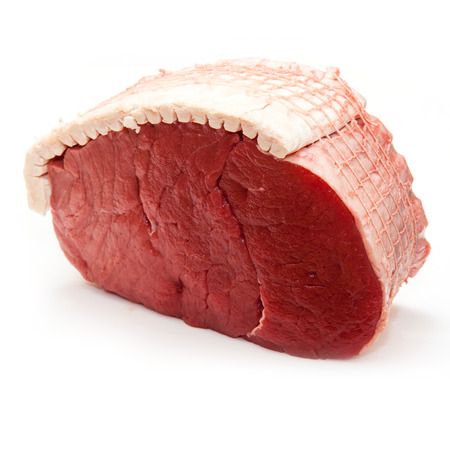Topside of British beef joint (0.8kg) isolated on a white studio.