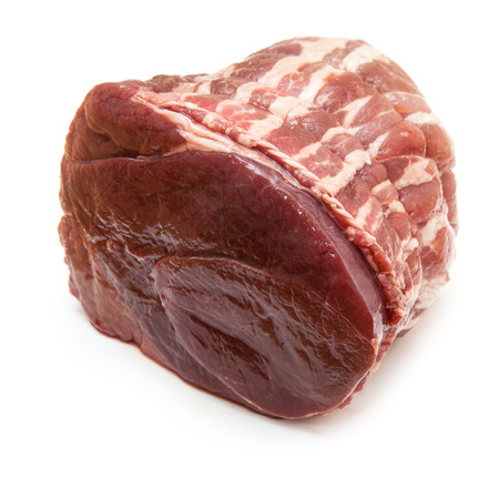 Haunch of venison wrapped in bacon isolated on a white background. Stock Photo