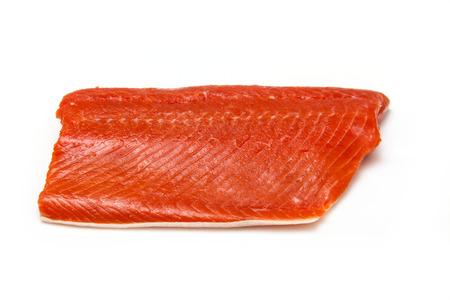 Wild Alaskan Sockeye or Coho Salmon fillet isolated on a white studio background.