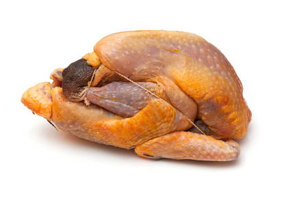 Guinea fowl uncooked isolated on a white studio background.