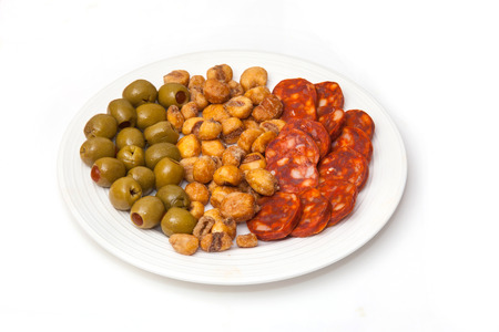 Plate of Spanish Tapas, Chorizo sausage, Salted Jumbo Corn, Pimento Stuffed Olives. photo