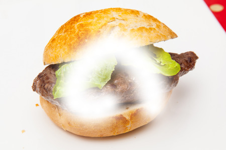 horse meat: Horse meat steak burger on a white studio background. Stock Photo