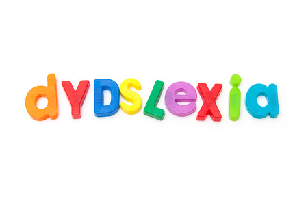 Dyslexia written in magnetic letters. on a white studio background.