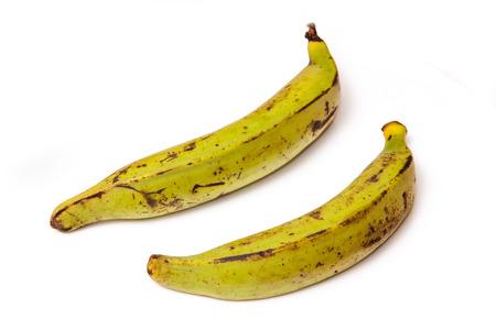 plantain: Plantain bananas isolated  on a white studio background. Stock Photo