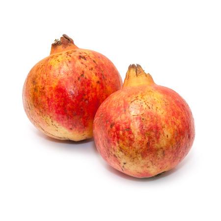 Pomegranate fruit , Punica granatum isolated on a white studio background. photo