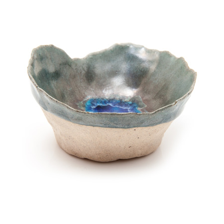 pinch: Handmade ceramic pinch pot isolated on a white studio background.