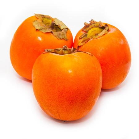 Persimon or sharon fruit isolated on a white studio background.
