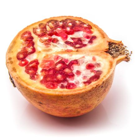 granatum: Pomegranate fruit , Punica granatum isolated on a white studio background. Stock Photo