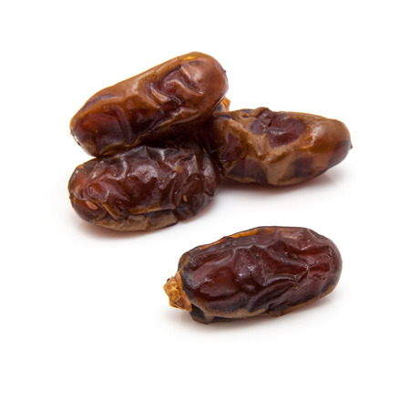 originate: Halawi dates isolated on a white background.  Halawi dates originate from date trees in the deserts and farms of Iraq. Halawi means sweet in Arabic