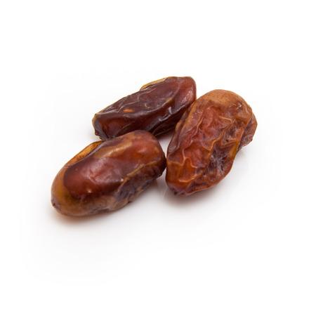 arabian food: Halawi dates isolated on a white background.