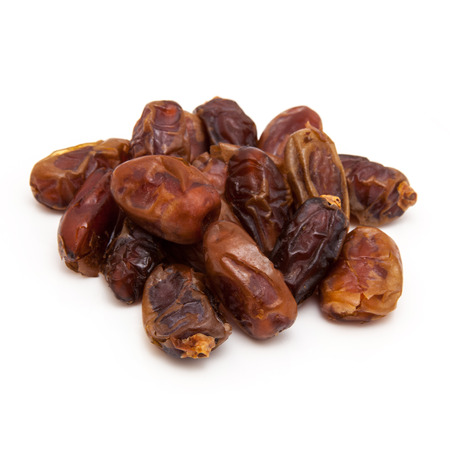 """arabian food: Dried Medjool dates isolated on a white background. Medjool dates are also called """"king of dates,"""" the """"diamond of dates,"""" or the """"crown jewel of dates"""""""