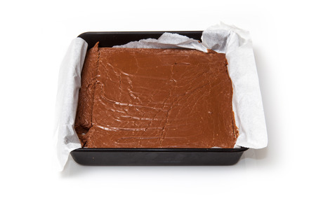 fudge: Tray of homemade fudge isolated on a white studio background. Stock Photo