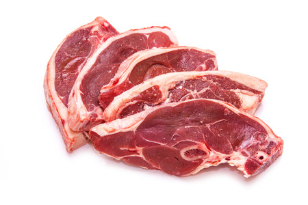 the lamb: Uncooked New Zealand lamb chops isolated on a white studio background.
