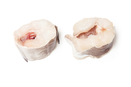 saltwater eel: European conger (Conger conger) fish steaks isolated on a white studio background.