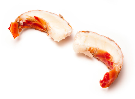 bahamian: Tropical Caribbean ( Bahamas )  lobster (Panuliirus argus) or spiny lobster tails isolated on a white studio background. Stock Photo