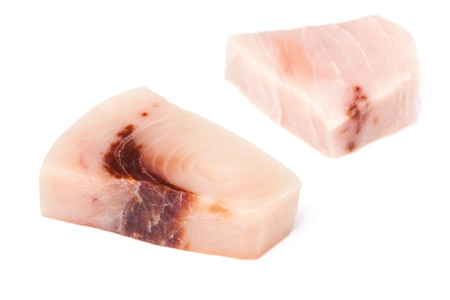 peces espada: Swordfish ( Xiphais gladius) steak portion uncooked and isolated on a white studio background.