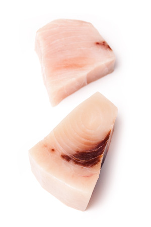 swordfish: Swordfish ( Xiphais gladius) steak portion uncooked and isolated on a white studio background.