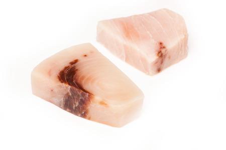 gladius: Swordfish ( Xiphais gladius) steak portion uncooked and isolated on a white studio background.