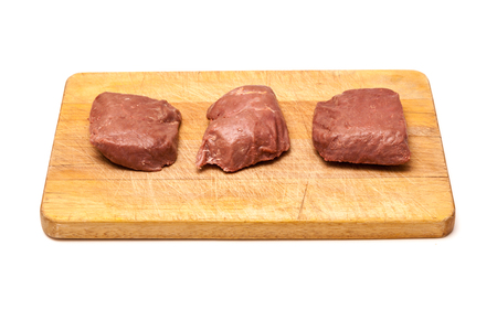 struthio camelus: Cooked Ostrich (Struthio camelus) meat steaks isolated on a white studio background. Stock Photo
