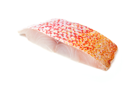 Raw Red Snapper fish fillets isolated on a white studio background.