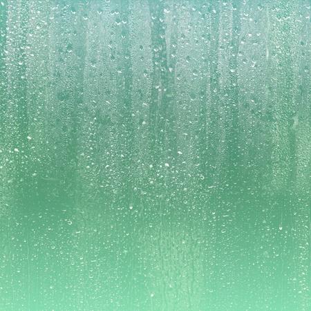 RAIN DROPS ON GLASS
