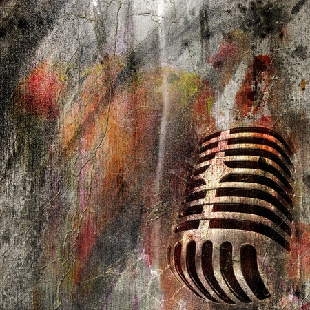 old microphone: GRUNGE  BACKGROUND WITH  MICROPHONE Stock Photo