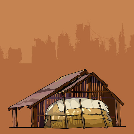 Old rustic barn with a large haystack