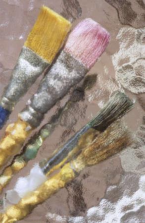 paintbrushes under glass