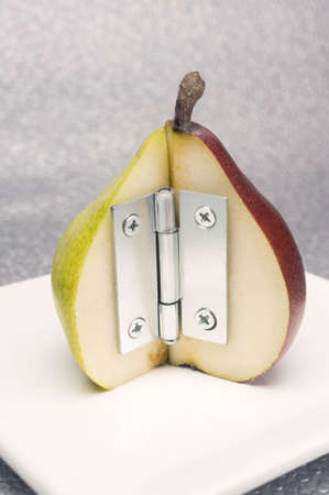 hinge: yellow and red pear with steel hinge Stock Photo