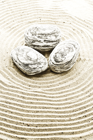 marmorate: Marble stones on sand,close up