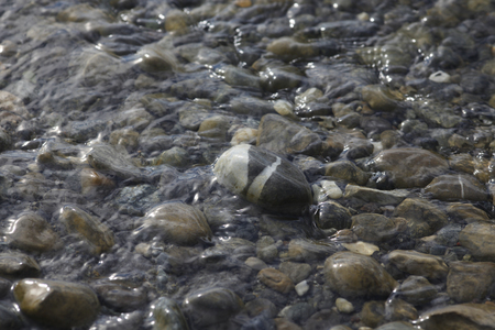 location shot: Germany,Gravel stones with water