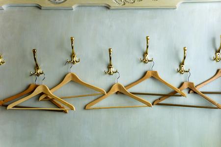 coathangers: Wood coathangers in wardrobe,close up