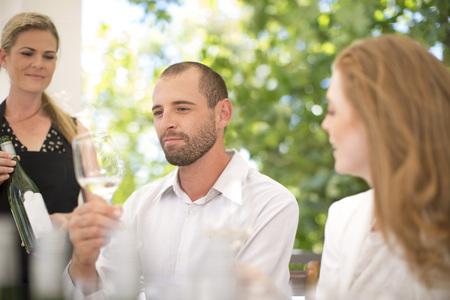 Man examining white wine on a wine tasting session