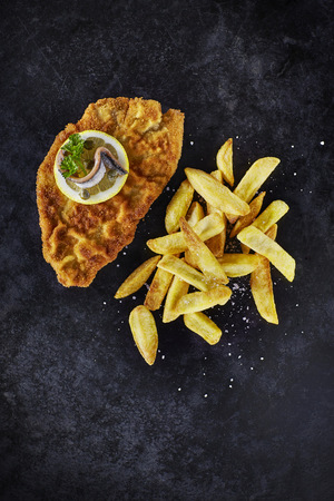 Escalope and French Fries on dark ground