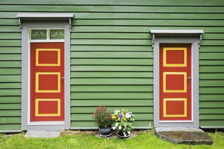 conformance: Norway, green wodden house facade, entry doors