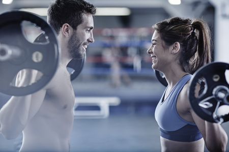 motivations: Man and woman doing fitness training with weights