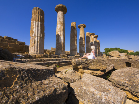 residue: Italy, Sicily, Pillars at the temple of Hercules in front of blue sky LANG_EVOIMAGES