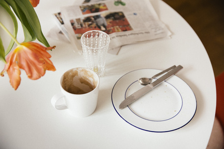 residue: Breakfast table with newspaper after using