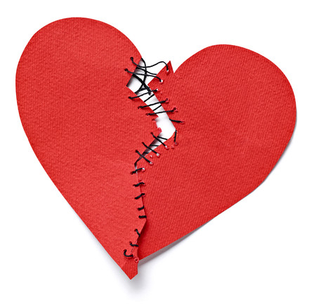 Broken heart tied up with thread