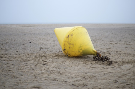 Netherlands, Goeree-Overflakkee, Buoy at beach LANG_EVOIMAGES