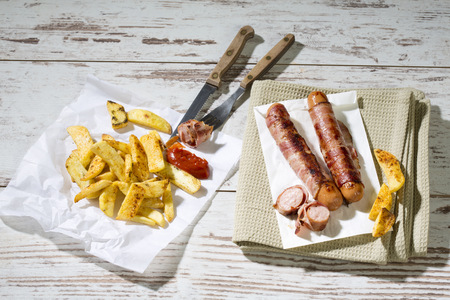 interiour shots: Bernese sausages with French Fries