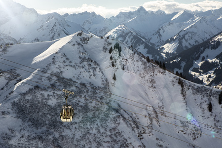 mountaintops: Austria, Vorarlberg, Riezlern, Mountainscape with cable car in winter LANG_EVOIMAGES