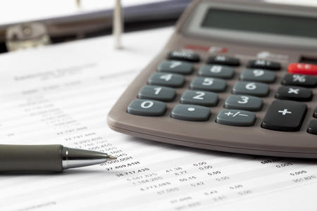 figuring: Pocket calculator, pen and documents LANG_EVOIMAGES