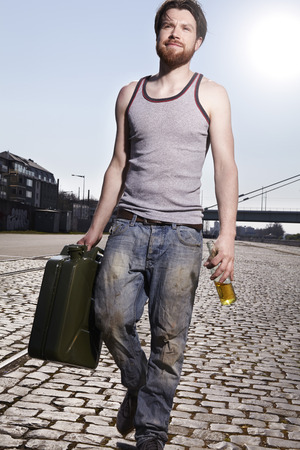 cruddy: Man walking with petrol can
