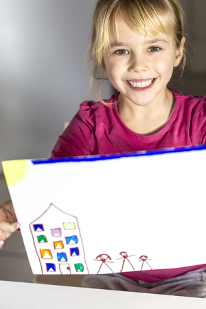 stickmen: Girl holding finished drawing of house and familiy LANG_EVOIMAGES