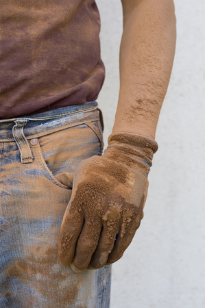 cruddy: Close-up of man with dirty working glove