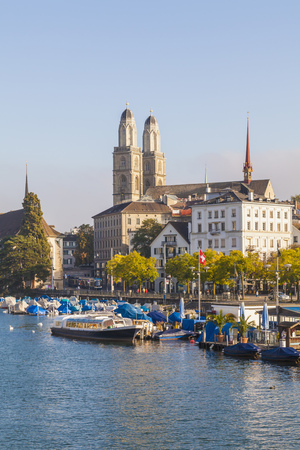 Switzerland, Zurich, River Limmat and pleasure boat at Uto Quai, Great Minster in the background